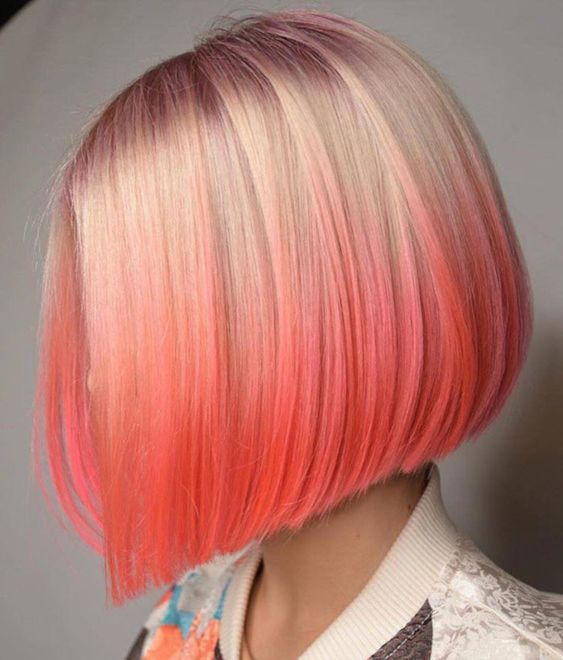 Hair With Colored Streaks Is One Of The Most Desired Bets To Have A Coral Color Hair