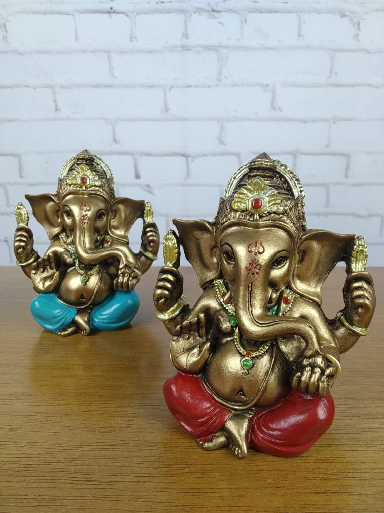 Ganesh Sitting With His Trunk Tilted