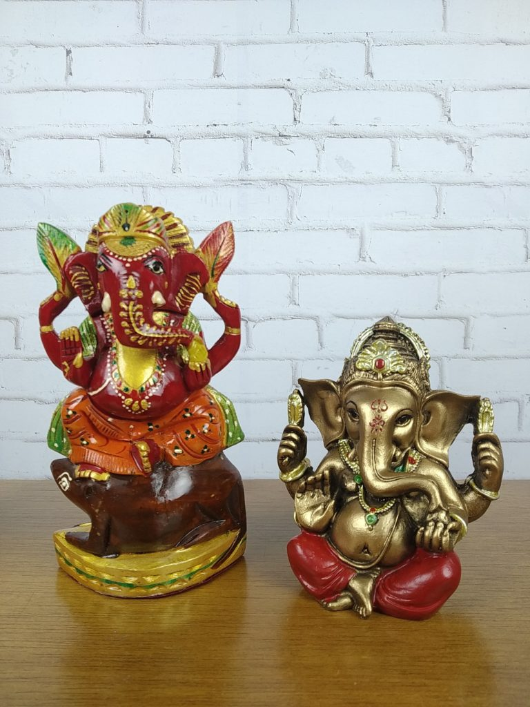 Ganesh With Some Red Item On The Vest